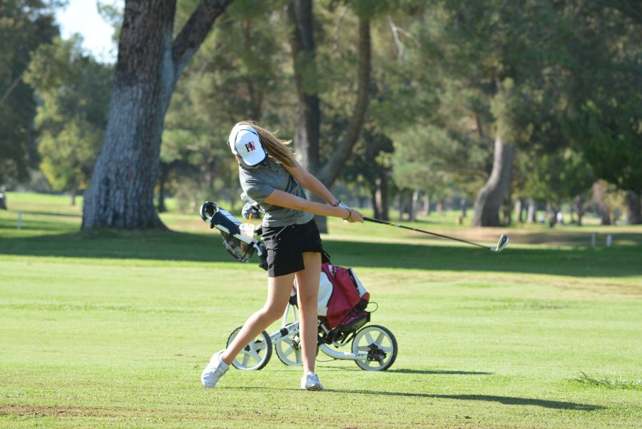 Girls+Golf+swings+into+action