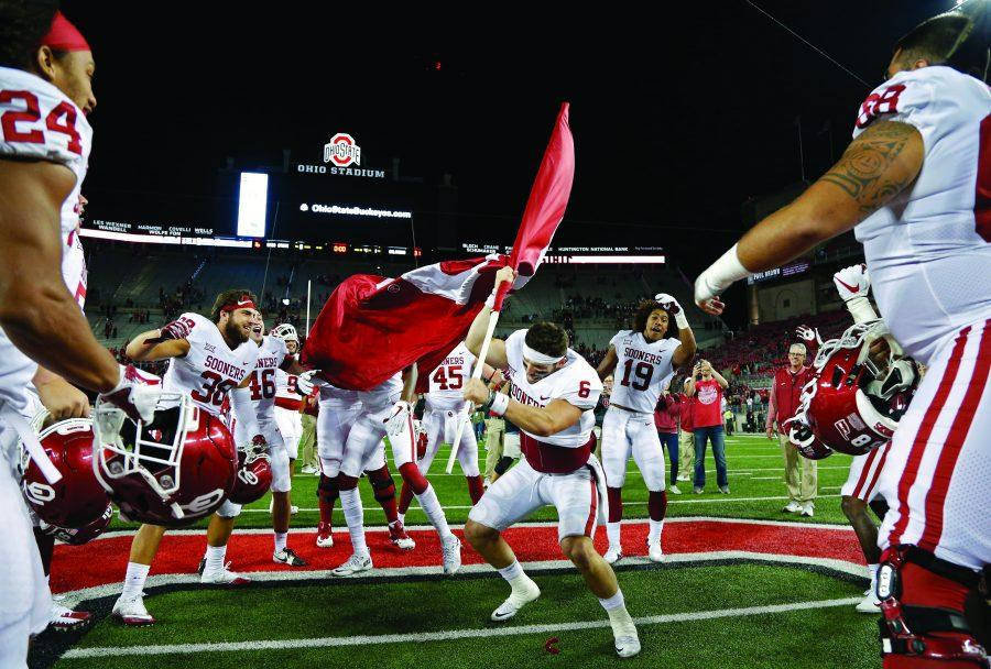 Oklahoma+quarterback+Baker+Mayfield+%286%29+plants+the+Sooner+flag+in+the+Ohio+State+logo+at+midfield+after+a+31-16+win+at+Ohio+Stadium+in+Columbus%2C+Ohio%2C+on+Saturday%2C+Sept.+9%2C+2017.+%28Kyle+Robertson%2FColumbus+Dispatch%2FTNS%29