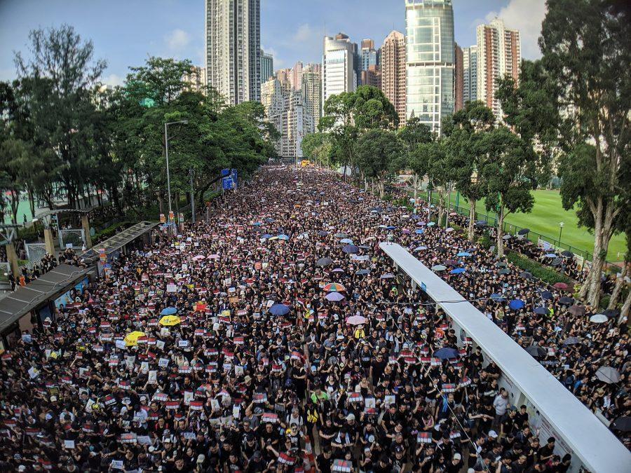 Thousands march on Hong Kong's streets in protest of proposed new laws believed to be in favor of China. Photo credit: Studio Incendo