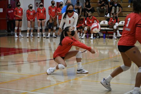 In the varsity girls volleyball Homecoming game against Providence High School on Oct. 2, #5 Sophia Jun 25 passes the ball. The Wolverines won all three games.
